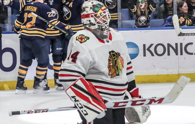 Chicago goaltender J-F Berube looks away from the celebration after Nick Baptiste, center, scores the game-winning goal and gets congrats from Johan Larsson (22) and Jason Pominville. (James P. McCoy/Buffalo News)