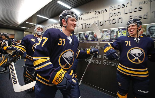 Sabres rookie Casey Mittelstadt (37) prepares to lead Evan Rodrigues (71), Robin Lehner (40) and the Sabres onto the ice Thursday night. (Harry Scull Jr./Buffalo News)