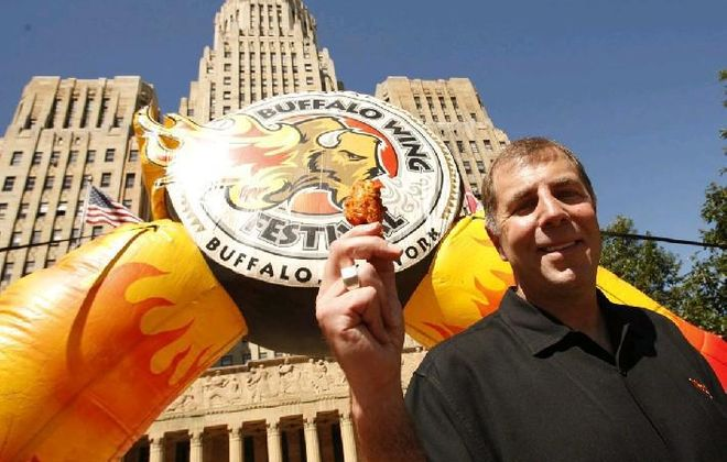 """""""Wing King"""" Drew Cerza holds up a """"jumbo"""" chicken wing at a news conference promoting the 2012 National Buffalo Wing Festival. Cerza is now starting a National Blue Cheese Dressing Day on July 16. {Derek Gee /Buffalo News file photo}"""