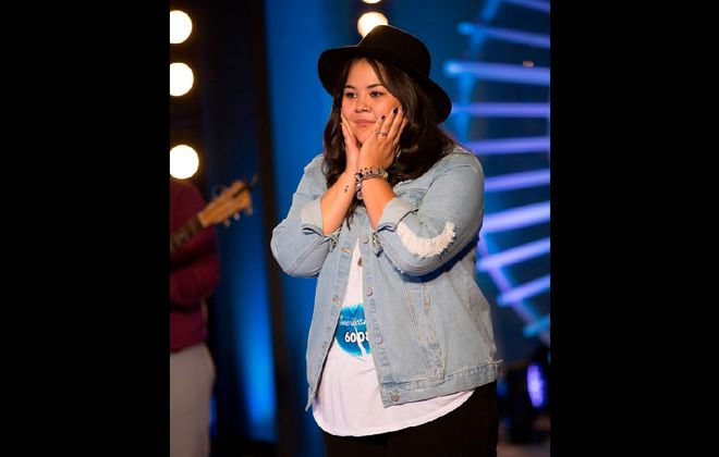 "Buffalo-area native Erika Hill reacts after her ""American Idol"" audition in New York City. A bus tour will stop in Buffalo for more auditions in late summer. (Eric Liebowitz/ABC)"