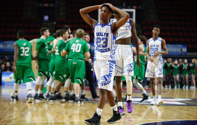 A disappointed Josiah Haygood walks off the court at Floyd L. Maines Arena in Binghamton following Health Sciences' double overtime loss to Seton Catholic on Friday night in the NYSPHSAA Class B semifinal. (Harry Scull Jr./Buffalo News)