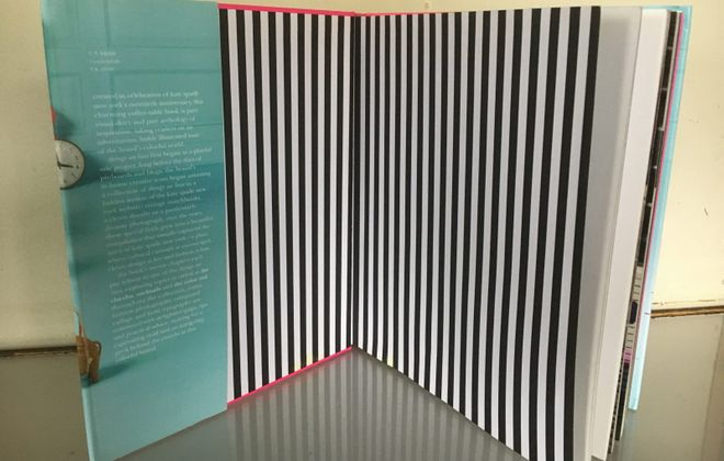 "Stripes show up in some unexpected places, such as inside book covers. Shown here: a peek  inside ""Kate Spade New York: Things we Love."" (Abrams)"
