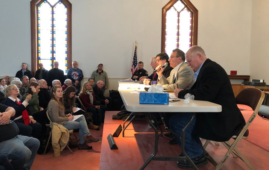 Assemblyman David DiPietro, with microphone, speaks Saturday, March 10, 2018, at a forum he hosted in East Aurora on the SAFE Act, a gun-control law approved by the state five years ago.  Other panelists included County Clerk Mickey Kearns and Sheriff Tim Howard.  (Buffalo News/Stephen T. Watson)