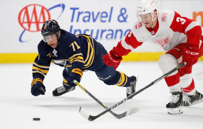 Buffalo's Evan Rodrigues and Detroit's Nick Jensen chase a loose puck during second period action at the KeyBank Center on Thursday. (Harry Scull Jr./Buffalo News)