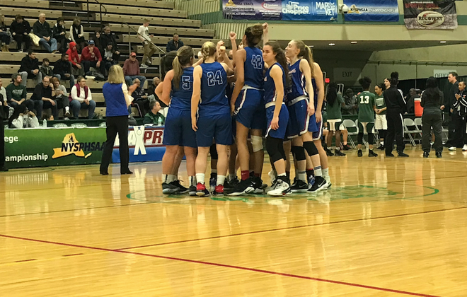The Williamsville South girls basketball team goes through its pregame ritual prior to playing in the NYSPHSAA Class A semifinals. The Billies lost the Section VIII's Elmont Memorial, 70-61.