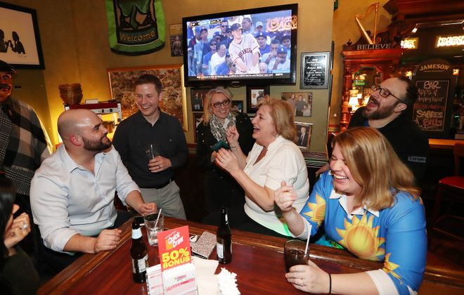 A group of coworkers has a good time in Sean Patrick's. (Sharon Cantillon/Buffalo News)