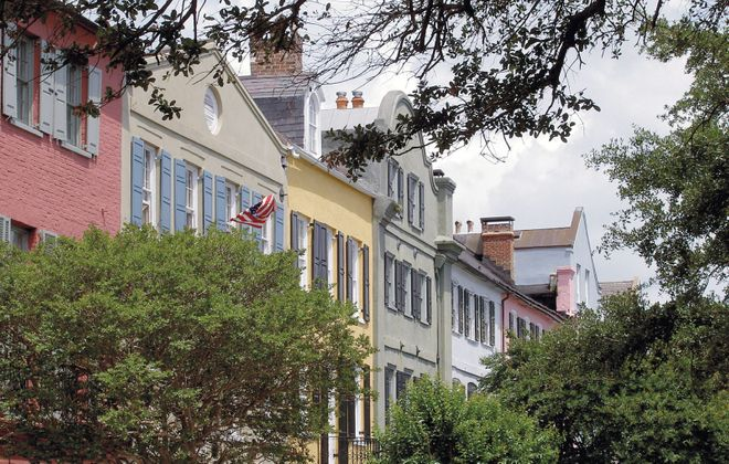 """Rainbow Row"" is the nickname for a cluster of 13 pastel-painted Georgian row houses in Charleston, S.C. (Explore Charleston)"