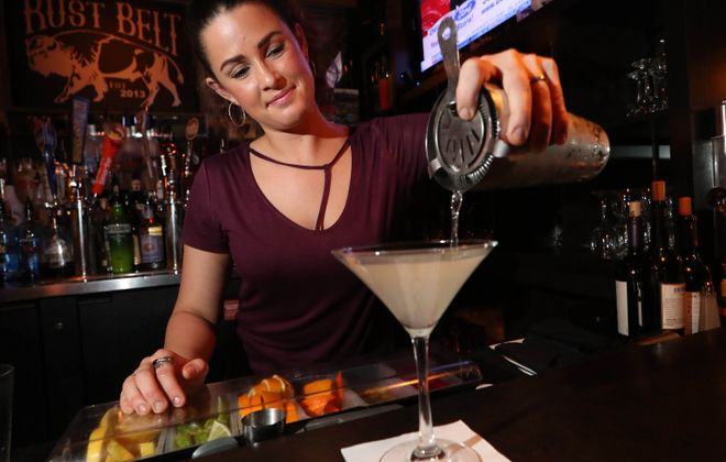 Rust Belt Bar & Grill bartender Theresa Hymes makes the Rust Belt Martini, a signature that includes white wine as one of its ingredients. (Sharon Cantillon/Buffalo News)