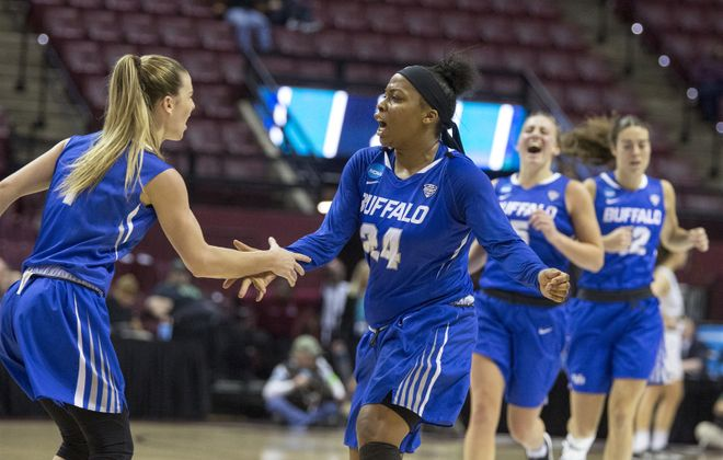 Buffalo guard Cierra Dillard celebrates making a three-point shot with Buffalo guard Stephanie Reid in the first half. (Mark Wallheiser/University at Buffalo)