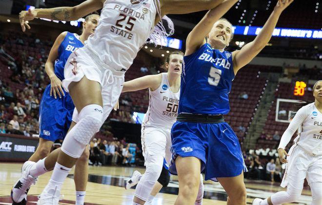 Florida State center Ama Degbeon (25) and Buffalo guard Katherine Ups battle for a rebound in the first half. Mark Wallheiser/University at Buffalo