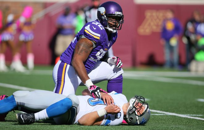 Vikings DT Tom Johnson gets up after hitting Detroit QB Matthew Stafford. (Getty Images)