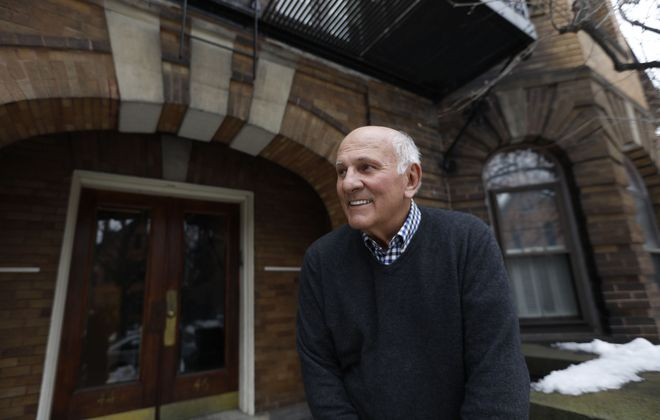 "Don Gilbert, owner of the apartment building at 44 N. Pearl St. in Allentown which was built in 1905.  He calls the building the ""Think Tank"" because of all the doctors and professionals who have lived there through the years. (Derek Gee/Buffalo News)"