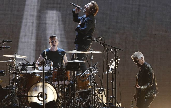 Bono, middle, puts on a show at New Era Field on Sept. 5, 2017. See the other recent bands who've graced the Orchard Park stage. (Sharon Cantillon/Buffalo News)