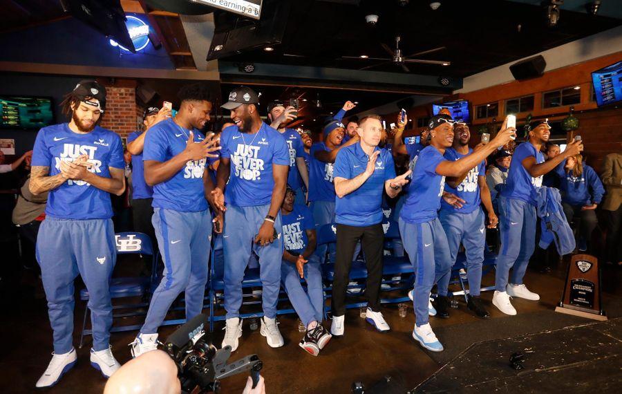 UB's men's basketball team reacts to its NCAA seeding. (Mark Mulville/Buffalo News)