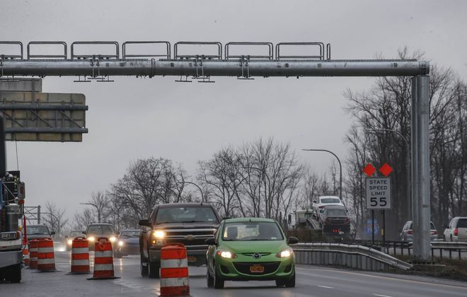 Vehicles pass beneath a gantry that will hold equipment for the cashless toll collection system on the I-190 at the North Grand Island Bridge. (Derek Gee/News file photo)