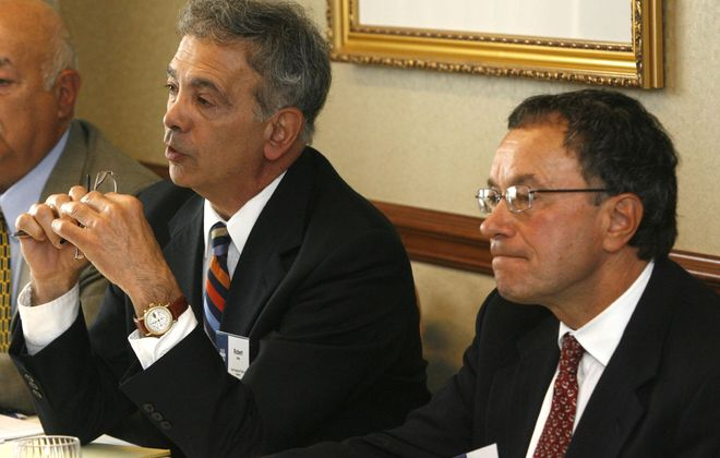 Robert Attea (left) and Kenneth Myszka will retire from the board of the company they co-founded. (News file photo)