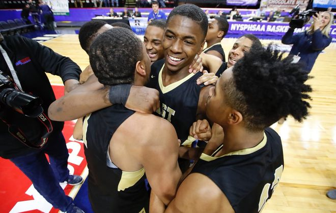 The East Panthers celebrate after winning the NYSPHSAA Class D boys basketball championship Saturday night at Floyd L. Maines Arena in Binghamton. (Harry Scull Jr./Buffalo News)