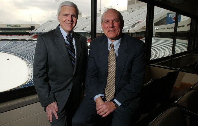 """Erland """"Erkie"""" Kailbourne (right), shown with then-Bills GM Tom Donahoe, is exiting Five Star Bank's board. (News file photo)"""