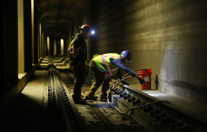 Crews perform overnight repair work on Metro Rail tracks near the Utica Street Station last year. The state is considering a $100 million capital program to address deteriorating conditions. (Mark Mulville/News file photo)