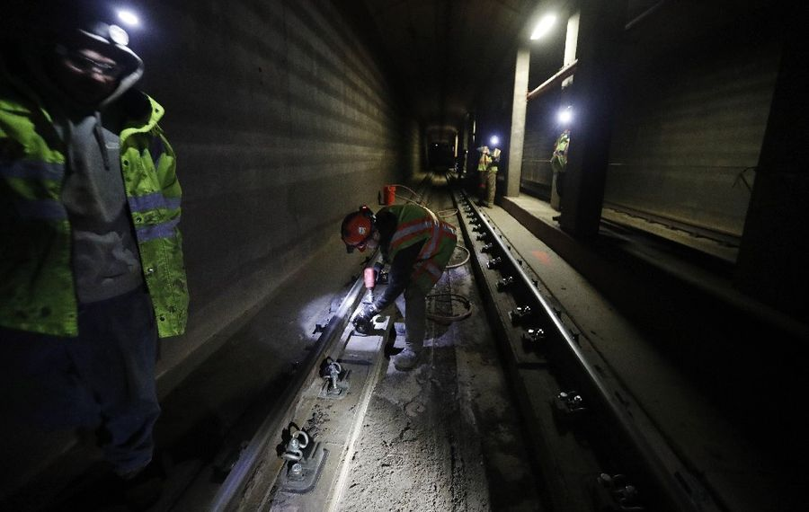 Crews perform overnight repair work on Metro Rail tracks near the Utica Street Station. Some state legislators are pushing for new state funding to address the aging system's deterioration. (Mark Mulville/Buffalo News)