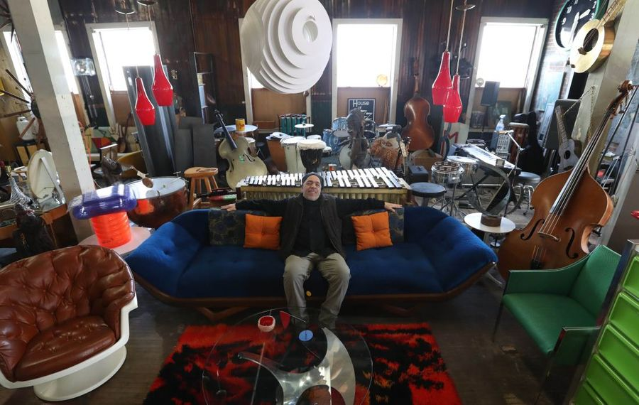 """Michael Merisola, the owner of Buffalo vintage shop CooCooU27, provided many of the set pieces for the Oscar-winning film """"The Shape of Water."""" (Sharon Cantillon/Buffalo News)"""