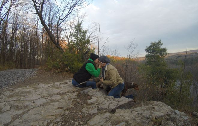 Michael Feldman and Lindsay Feraco, seconds after Michael proposed last autumn, Clark's Reservation, Jamesville. Michael's dog Duncan is also pictured. (Family photo)
