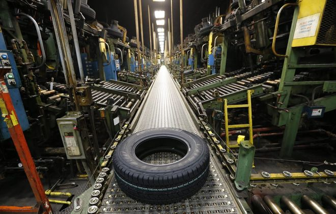 A new Falken tire comes off the curing line at the Sumitomo Rubber North America tire manufacturing plant in Tonawanda in November 2016. Sumitomo is in the middle of an $87 million plant expansion. (Derek Gee/News file photo)