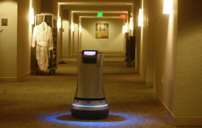 """""""Chip,"""" the robot butler, has been delivering towels, toothpaste, candy, cocktails and newspapers to hotel guests at the Westin Buffalo on Delaware Avenue since March. So why not invent a robot to help smokers quit?  (John Hickey/Buffalo News file photo)"""