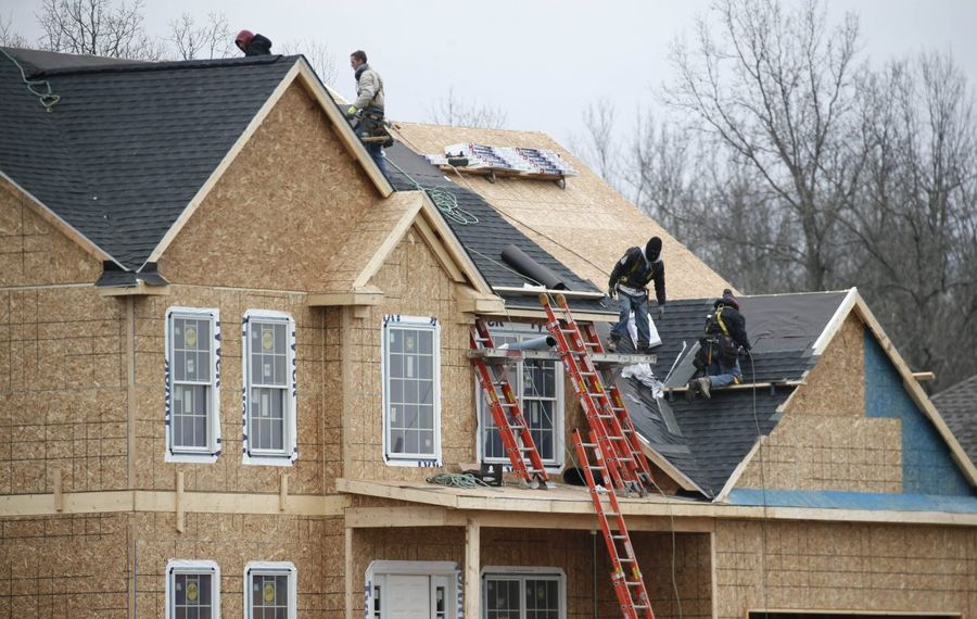 Workers build a home on Creekview Drive in Bear Ridge Estates in Pendleton. (Derek Gee/Buffalo News)