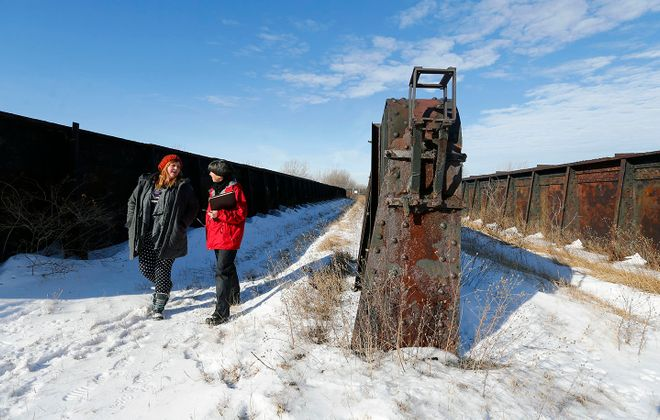 "Sara Heidinger, left, and Nancy Smith explore an old rail bed envisioned to be part of Buffalo's ""High Line."" (Mark Mulville/Buffalo News)"