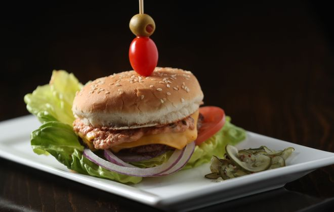 """At $5, the Thrasher Burger is """"a bar snack star."""" It's a 50/50 grind of top round and bacon, lettuce, tomato and onion and remoulade.  Cheese and extra patties may be added. (Sharon Cantillon/Buffalo News)"""