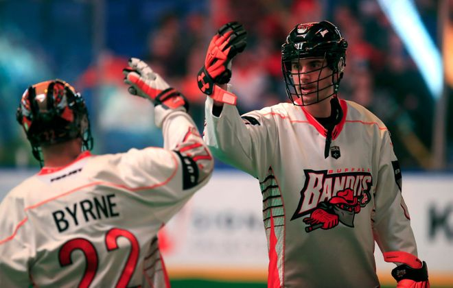 Buffalo Bandits Josh Byrne and Kevin Brownwell greet each other during introductions prior to playing the Calgary Roughnecks at the KeyBank Center on Saturday, Jan. 6, 2018. (Harry Scull Jr./Buffalo News)