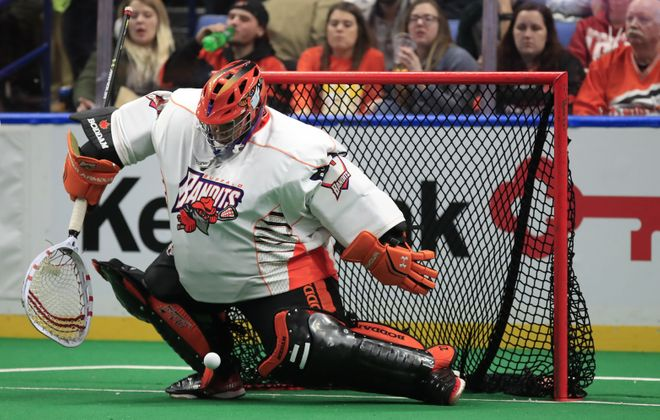 Buffalo Bandits gaoltender Alex Buque makes a save on the Calgary Roughnecks during first-half action at the KeyBank Center. (Harry Scull Jr./ Buffalo News)