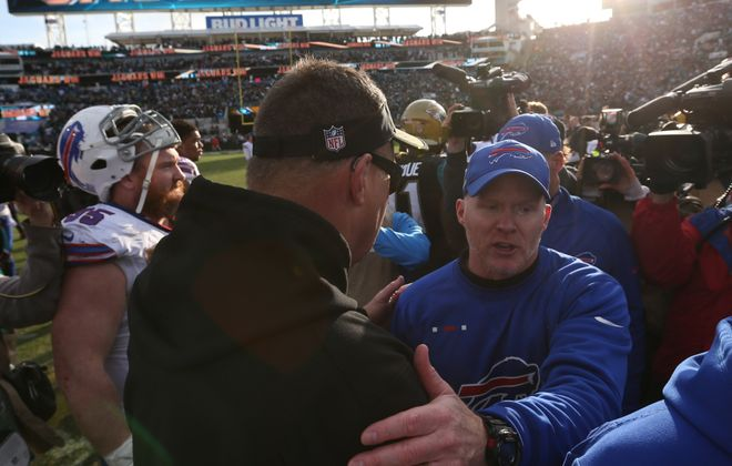 Buffalo Bills head coach Sean McDermott and Jacksonville Jaguars head coach Doug Marrone shake hands at the end of the game.  (James P. McCoy / Buffalo News)