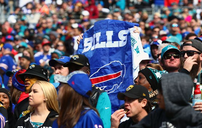 Bills fans cheer on their team during the playoff game in Jacksonville. (James P. McCoy/News file photo)