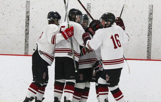 Starpoint's Blake Dewey (16) celebrates a goal with his teammates. He scored the game-winning goal Sunday for Starpoint in a 3-1 win over Williamsville South in the Section VI Division II championship game. (James P. McCoy/News file photo)