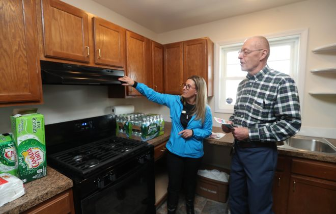 Habitat for Humanity celebrates its 300 house at in the city of Buffalo at 42 Wende St., as well as welcome the Hissu family to their brand  new, four-bedroom home, Saturday, Jan. 20, 2018. Habitat Executive Director Teresa Bianchi, left, and founder of Habitat Buffalo Ron Talboys admire the kitchen. (Sharon Cantillon/Buffalo News)