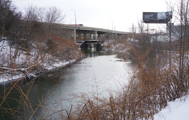 Scajaquada Creek as it flows underneath Route 198 in Buffalo receives millions of gallons less of Cheektowaga's sewage and stormwater as the result of improvements funded by state water quality improvement grants and loans. (Derek Gee/Buffalo News file photo)