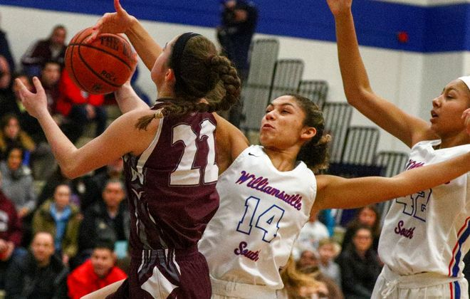 Sacred Heart's Siobhan Ryan battles Williamsville South's Naomi DeBerry for the ball in the first half of the Billies' victory Wednesday. (James P. McCoy/Buffalo News)
