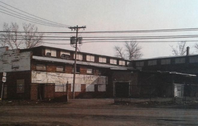 This building at 211 Main St., North Tonawanda, condemned in 2015, is to be renovated into architectural offices by Enterprise Silo and Lumber. (Buffalo News file photo)
