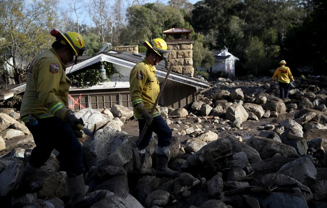 Firefighters search for people trapped in mudslide debris on January 10, 2018 in Montecito, California. 15 people have died and hundreds are still stranded after massive mudslides crashed through Montecito, California early Tuesday morning.  (Getty Images)