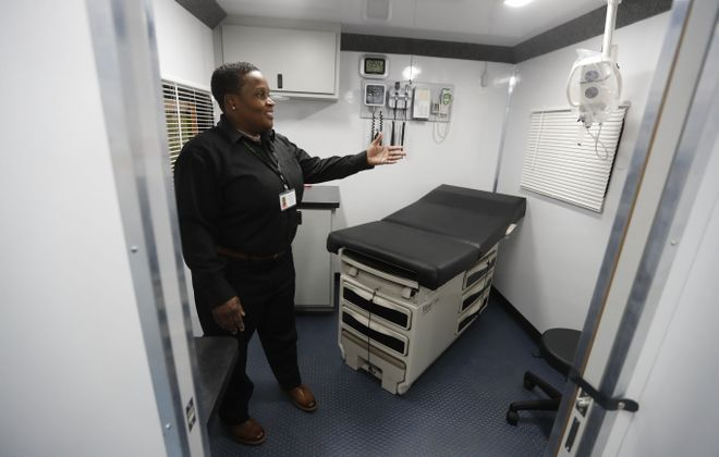 BestSelf Behavior Health  peer specialist Mona Lisa McEachin tours one of the mobile addiction treatment vehicles during its unveiling Tuesday, Jan. 23, 2018, in Kenmore. (Mark Mulville/Buffalo News)