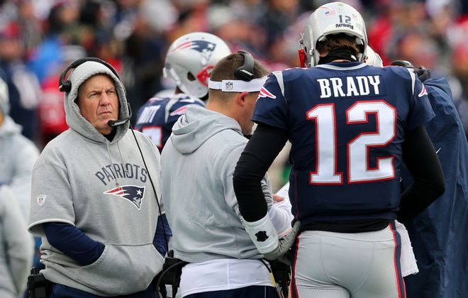 Head coach Bill Belichick of the New England Patriots and Tom Brady on the sideline during the first half against the Bills at Gillette Stadium on Dec. 24, 2017, in Foxboro, Mass. (Getty Images)