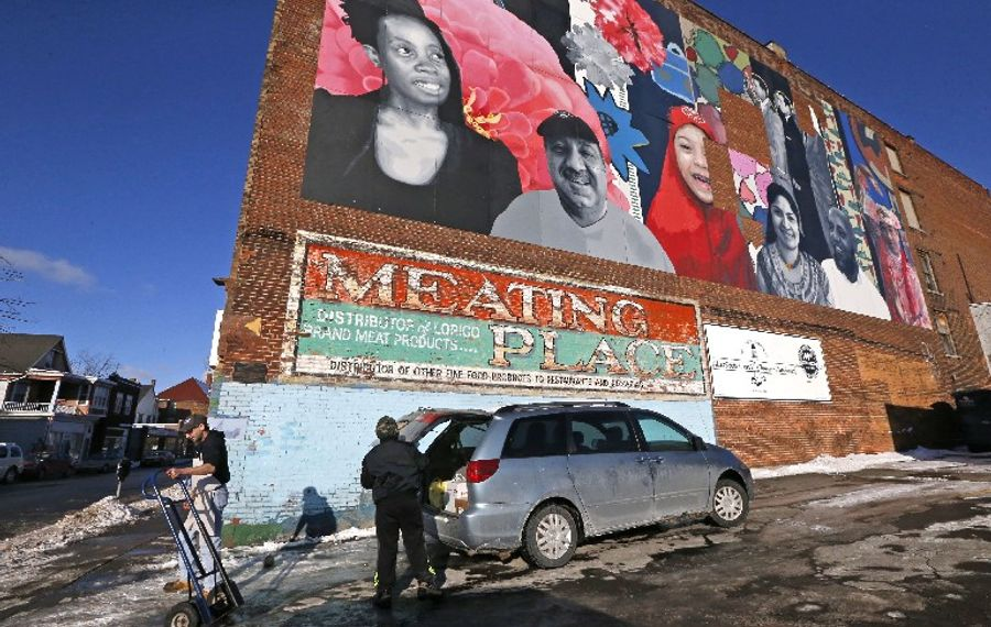 A mural on the wall of the Meating Place market celebrates the rich diversity of the area on Grant Street. The once forlorn street is staging a welcome comeback. (Robert Kirkham/Buffalo News)