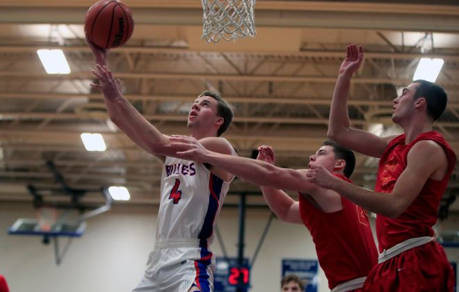 Williamsville South's Greg Dolan drives to the basket during the Billies' 74-40 win over Williamsville East. (Harry Scull Jr./Buffalo News)