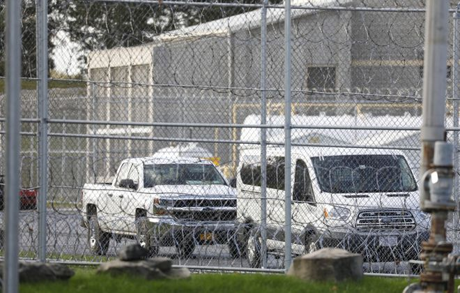 Fences with barbed wire surround the Federal Detention Center in Batavia.  (Derek Gee/Buffalo News)