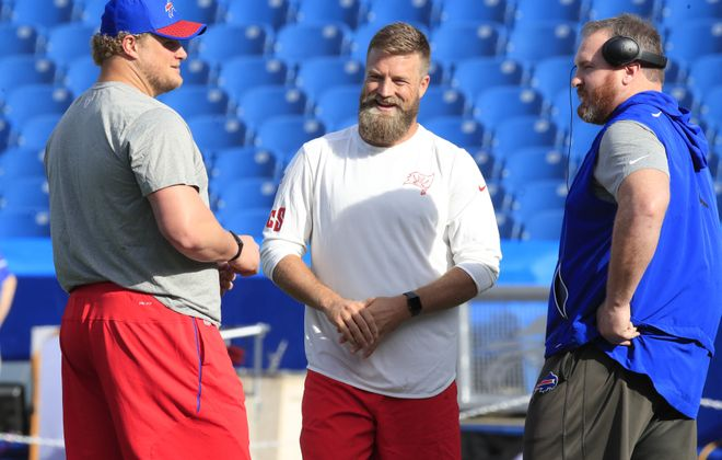 Upon hearing of the end of the playoff drought for Buffalo, former Bills quarterback Ryan Fitzpatrick immediately sent congratulatory texts to Eric Wood (left) and Kyle Williams, the only two current Bills who were his teammates from 2009-13. (Harry Scull Jr./News file photo)