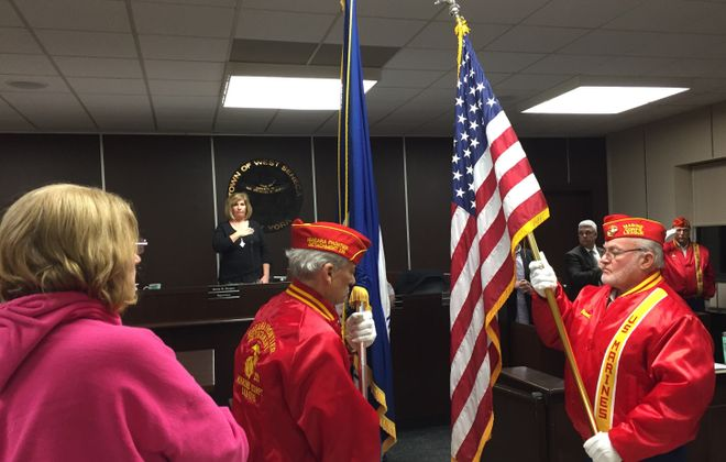 Members of Marine Corps League 239 change the colors at West Seneca Town Hall Monday night. (Barbara O'Brien/Buffalo News)