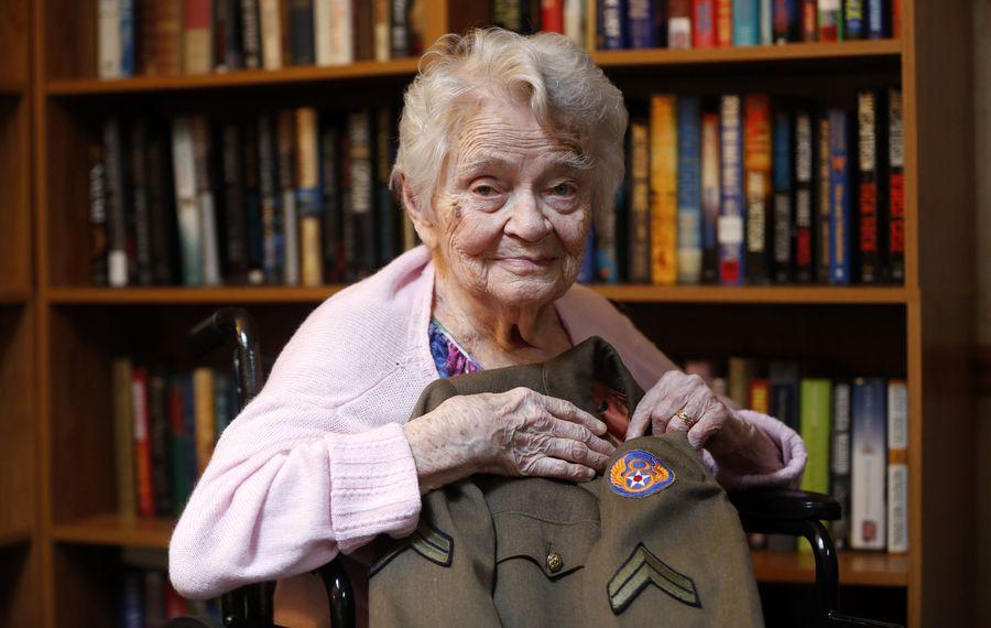 World War II veteran Henrica Kiernan holds the uniform she wore during the war at her home in Eden on Thursday, Jan. 11, 2018.  (Mark Mulville/Buffalo News)