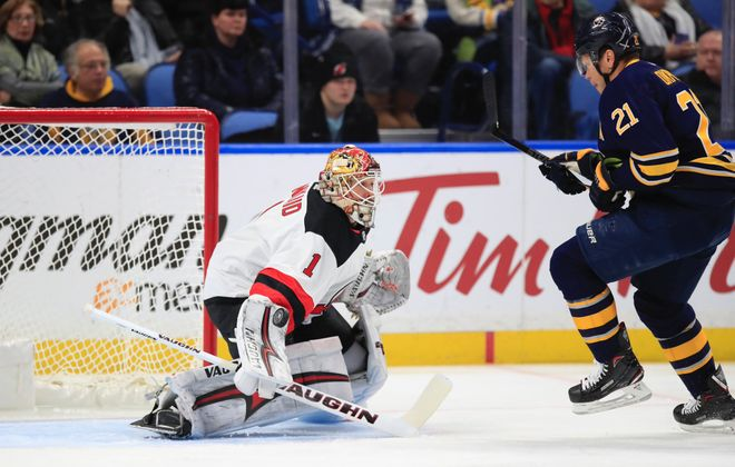 Kyle Okposo is stopped by Devils goalie Keith Kinkaid (Harry Scull Jr./Buffalo News).